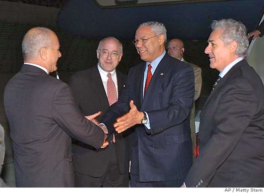 In this photo released by the U.S. Embassy, U.S. Secretary of State Colin Powell is greeted by Yoram Ben Zeev Deputy Director-General of Foreign Ministry North American Division, left, U. S. Ambassador to Israel Daniel C. Kurtzer, second from left, and Israeli Chief of Protocol Yitzhak Eldan, right, upon his arrival at Israel's Ben Gurion airport, Sunday, Nov. 21, 2004, near Tel Aviv, Israel. (AP Photo/U.S. Embassy, Matty Stern) #MainNews#Chronicle#11/22/2004####0422479120 Photo: MATTY STERN
