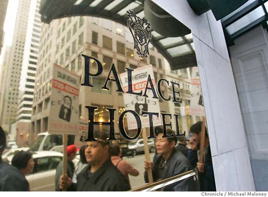 HOTELS_155.jpg  Locked out employees of the Palace Hotel on New Montgomery Street are reflected in the polished brass sign near the main entrance.  Two days after workers at four San Francisco hotels went on strike, management at ten other major city hotels have locked out their workers. A negotiating group representing the hotels started the lockout at five o�clock this morning. More than 1,400 union workers from four other hotels - the Argent Hotel, the Crowne Plaza, the Hilton and the Mark Hopkins - walked off the job Wednesday over stalled contract negotiations. The hotels and the union have been unable to reach an agreement on a number of issues including health care costs and work loads. Photo by Michael Maloney / San Francisco Chronicle MANDATORY CREDIT FOR PHOTOG AND SF CHRONICLE/ -MAGS OUT Metro#Metro#Chronicle#11/22/2004#ALL#5star##0422387072 Photo: Michael Maloney