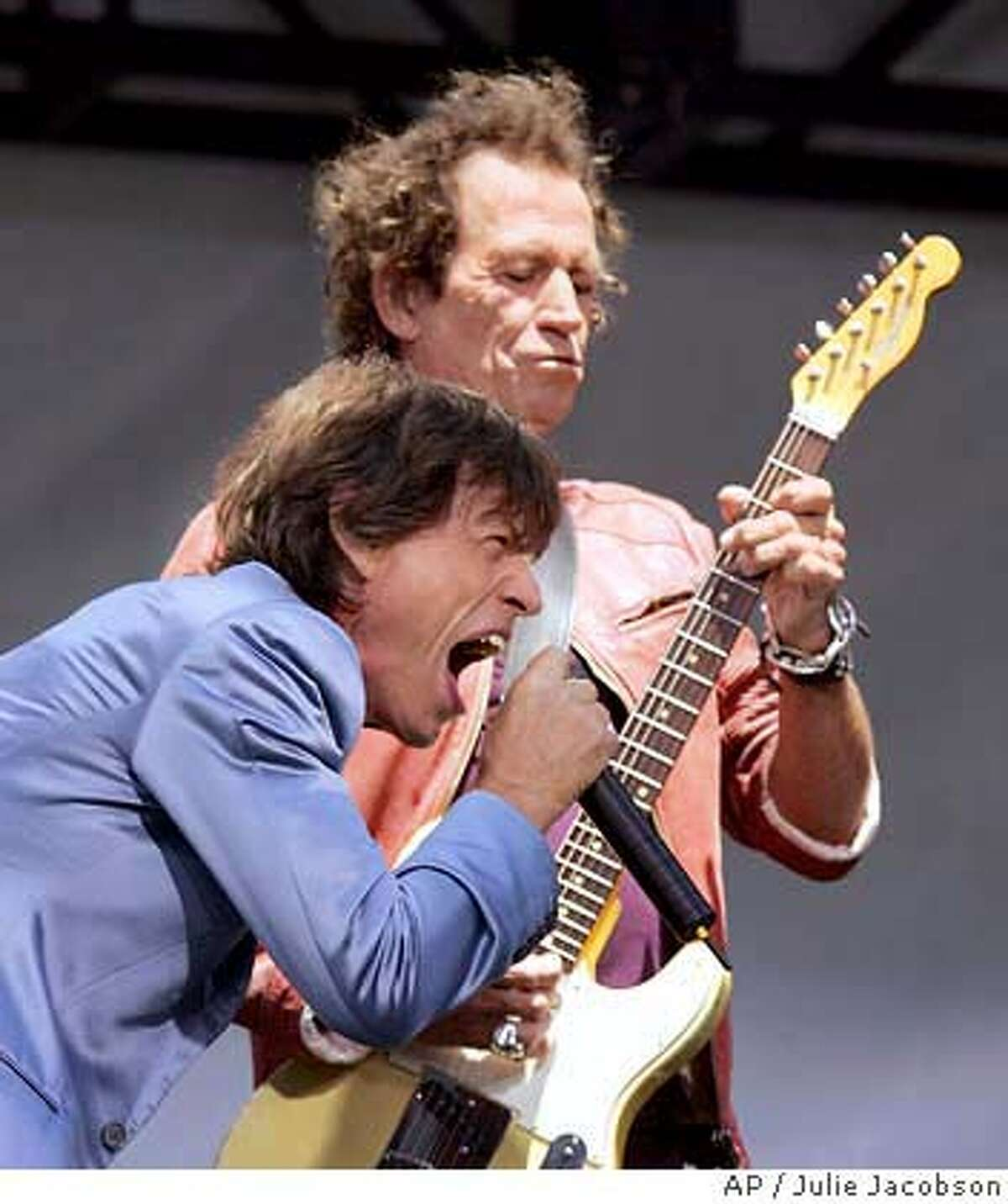 Mick Jagger,foreground, and Keith Richards of the Rolling Stones perform Tuesday May 10, 2005 at the Juilliard School of Music in New York. The group announced their new concert tour.(AP Photo/Julie Jacobson)