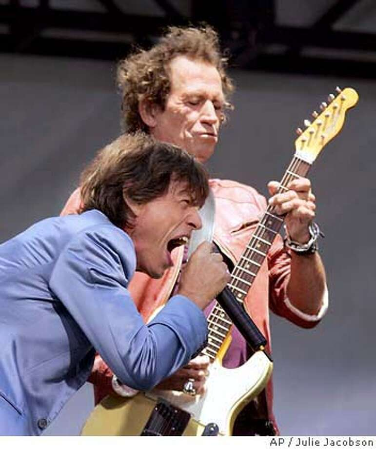 Mick Jagger,foreground, and Keith Richards of the Rolling Stones perform Tuesday May 10, 2005 at the Juilliard School of Music in New York. The group announced their new concert tour.(AP Photo/Julie Jacobson) Photo: JULIE JACOBSON