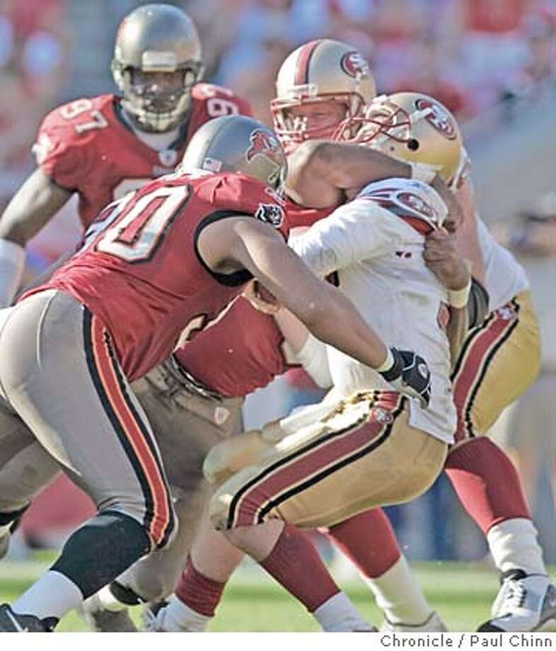 Tim Rattay was sacked by Chidi Ahanotu and Dewayne White deep in the 49ers' zone in the fourth quarter. San Francisco 49ers vs. Tampa Bay Buccaneers at Raymond James Stadium on 11/21/04 in Tampa, FL. PAUL CHINN/The Chronicle Photo: PAUL CHINN