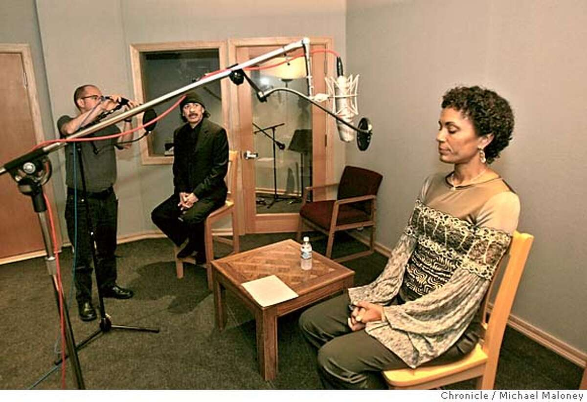 """SANTANA_ 3_MJM.jpg Deborah Santana closes her eyes to collect her thoughts as a sound technician works on Carlos' mic stand prior to recording. Musician Carlos Santana sits in on a recording session for his wife Deborah Santana's new audio book, """"Space Between the Stars : My Journey to an Open Heart"""". The book is autobiographical in nature and is due out next year along with the audio book. Both Carlos and Deborah were recording their thoughts on their marriage during this session at the Polarity recording studios in SF. Photo by Michael Maloney / San Francisco Chronicle MANDATORY CREDIT FOR PHOTOG AND SF CHRONICLE/ -MAGS OUT Datebook#Datebook#Chronicle#11/22/2004##Advance##0422403368"""