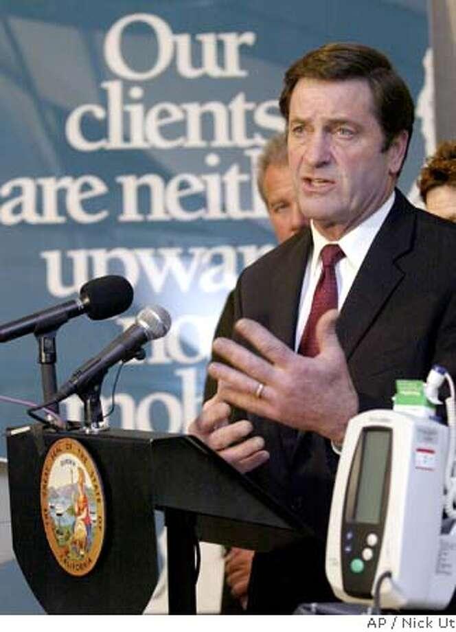 Insurance Commissioner John Garamendi , speaks press conference at Los Angeles Free Clinic in Los Angeles Tuesday, Nov 9, 2004. (AP Photo/Nick Ut) Photo: NICK UT