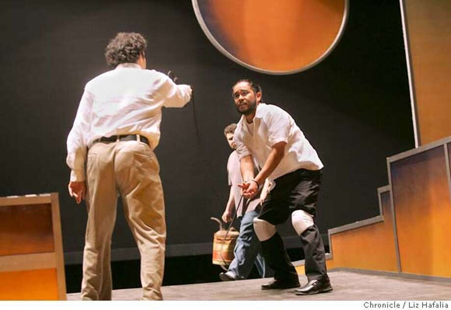 At left is George Castillo playing Fernie and at right is Jaime Avelar-Guzman playing Camacho. In the background with gas can is David Cavallero playing Mike. A rehearsal of Teatro Vision's version of Octavio Solis' play at Mexican Heritage Plaza.  Photo by Liz Hafalia/ The San Francisco Chronicle  Photo taken on 5/12/05, in San Jose, CA Photo: Liz Hafalia