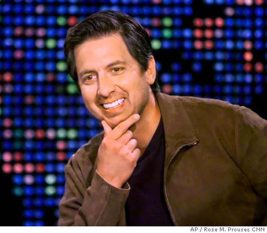 "In this photo provided by CNN, Actor Ray Romano, star of the television comedy series ""Everybody Loves Raymond,"" gestures as he is interviewed by talk show host Larry King during Romano's appearance with cast members on the CNN program ""Larry King Live"" at the CNN studios in Los Angeles, Tuesday, May 10, 2005. (AP Photo/CNN, Rose M. Prouser) PHOTO PROVIDED BY CNN Photo: ROSE PROUSER"