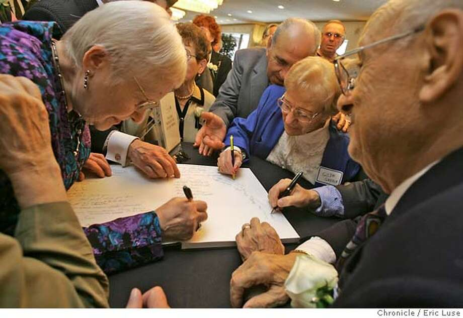 0044_holocaust16_el.JPG  Survivors and families scrambled to sign their names and comments in a guest book at the entrance to the luncheon. HOLOCAUST16 � Burress. (Impellizzeri.) (Photos.) About a thousand survivors of the holocaust gather for lunch at the Hilton in San Francisco to remember the devastation and heroism of the time. 20-25 inches. TND: 5:30 p.m. Sunday.  For A1 consideration. May be good to have individual portraits. Check in with reporter on Friday and at the scene.  ***PAUL SCHWARZBART 415.456.9191 san rafael, HELLA WEISS 415.750.9855 sf, MAX DRIMMER 650.692.1222  Event on 5/15/05 in San Francsico. Eric Luse / The Chronicle MANDATORY CREDIT FOR PHOTOG AND SF CHRONICLE/ -MAGS OUT Photo: Eric Luse