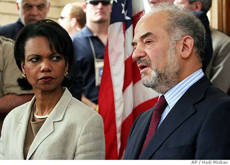 U.S. Secretary of State Condoleezza Rice listens while Iraqi Prime Minister Ibrahim al-Jafaari speaks at a press conference in Baghdad's fortified Green Zone in Iraq, Sunday, May 15, 2005. Rice arrived under very heavy security to meet Iraqi leaders grappling with a wave of insurgent attacks that have killed more than 400 people since a new government was formed on April 28. (AP Photo/Hadi Mizban) Photo: HADI MIZBAN