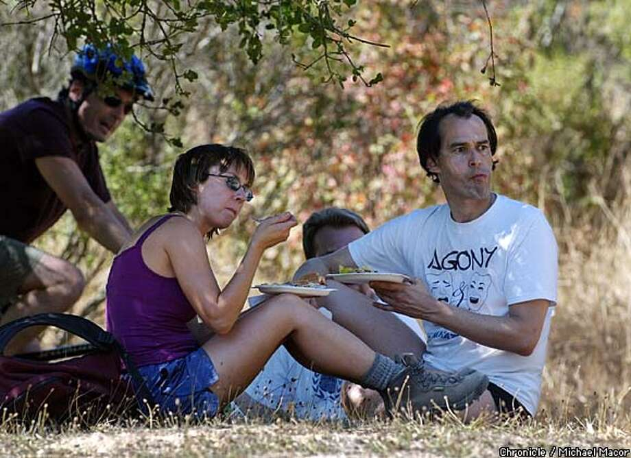 Lorraine Kendra, left, and Jeff Sanchez have lunch during a Sierra Singles trip in the Oakland hills. Chronicle photo by Michael Macor