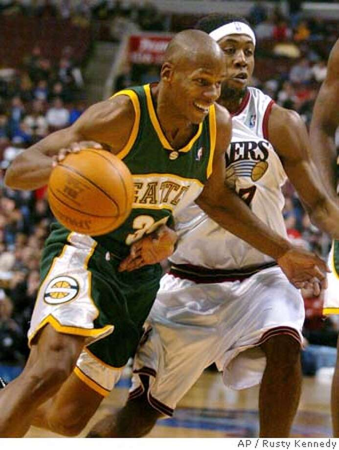 Philadelphia 76ers' John Salmons, right, fouls Seattle SuperSonics' Ray Allen as he tries to keep Allen from the basket in the first half Tuesday, Nov. 16, 2004, in Philadelphia. (AP Photo/Rusty Kennedy) Sports#Sports#Chronicle#11/21/2004#ALL#2star##0422470677 Photo: RUSTY KENNEDY