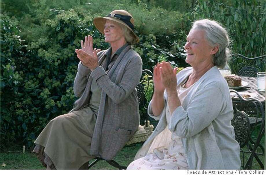"In this photo provided by Roadside Attractions, Ursula (Judie Dench) and Janet (Maggie Smith) Widington are two sisters that have their peaceable Cornwall existence disrupted in 1936 when they take a young Polish violinist into their care in ""Ladies in Lavender."" (Roadside Attractions/Tom Collins) Ran on: 05-08-2005  Maggie Smith and Judi Dench in &quo;Ladies in Lavender.&quo; Photo: TOM COLLINS"