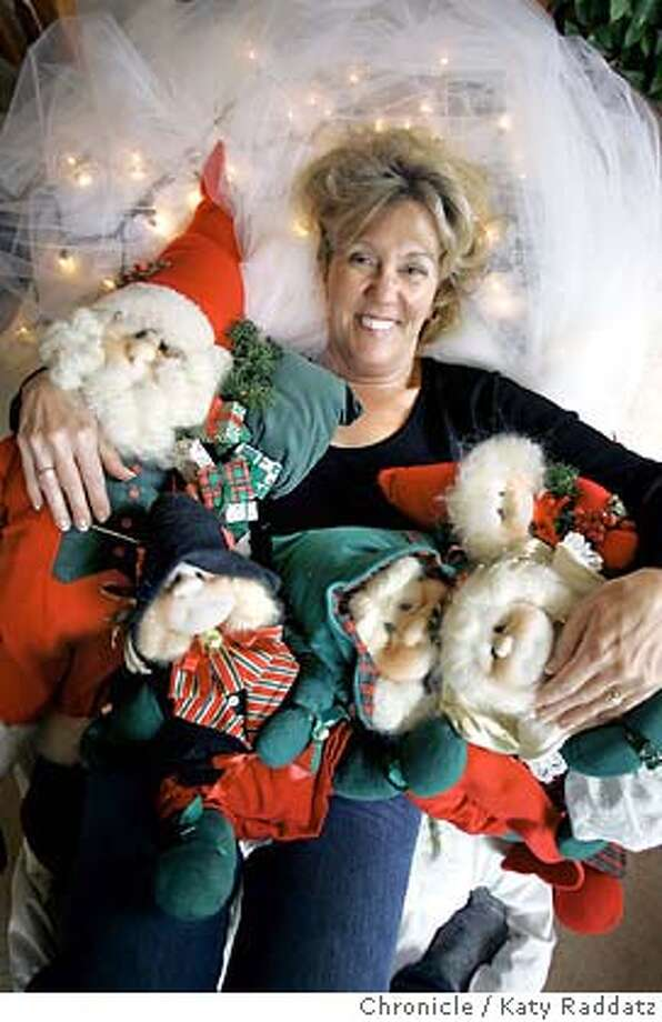 "DECOR21.2_rad.jpg Story about holiday decor becoming a huge phemonenon. SHOWN: Marty Daniels spends around 40 hours decorating her house with Christmas stuff. One of her favorite things is a group of dolls called ""Runzel Folk"" dolls, which means, ""wrinkled people"" in German, and are made by Kandy Weston in Auburn, CA. (Marty Daniels 2449 Skylark Way Pleasanton 925-462-6634) Katy Raddatz / The Chronicle Photo: Katy Raddatz"