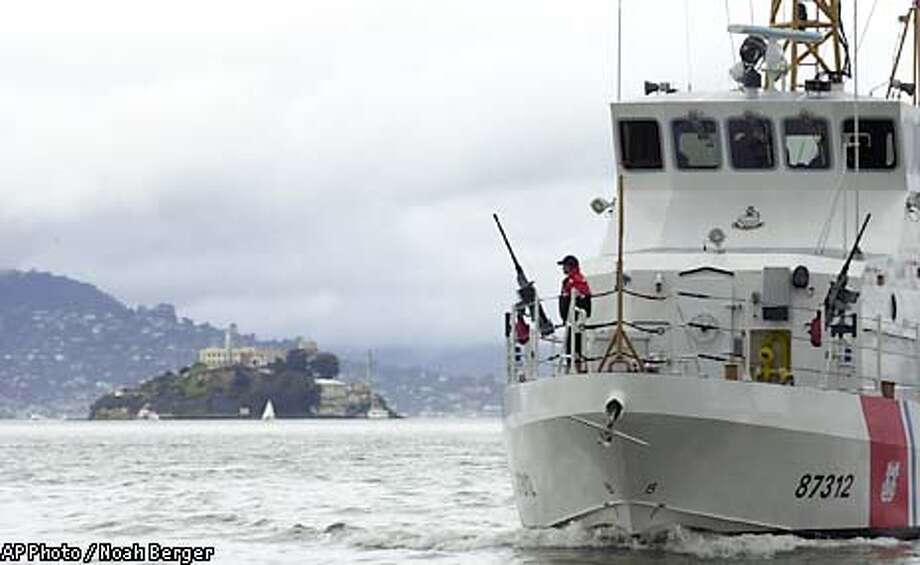 ** CORRECTS DATE TO FEB. 13, 2003, NOT JAN. 13, 2003 ** The United States Coast Guard cutter Hawksbill passes Alcatraz during a homeland security patrol on Thursday, Feb. 13, 2003, on the San Francisco Bay, Calif. (AP Photo / Noah Berger) Photo: NOAH BERGER