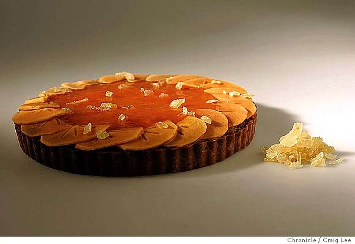 Thanksgiving food. Food styled by Kate Benfield. Photo of a Two Persimmon Tart with and Almond base. Event on 10/30/04 in San Francisco. Craig Lee / The Chronicle Food#Food#Chronicle#11/17/2004##Advance##0422440240