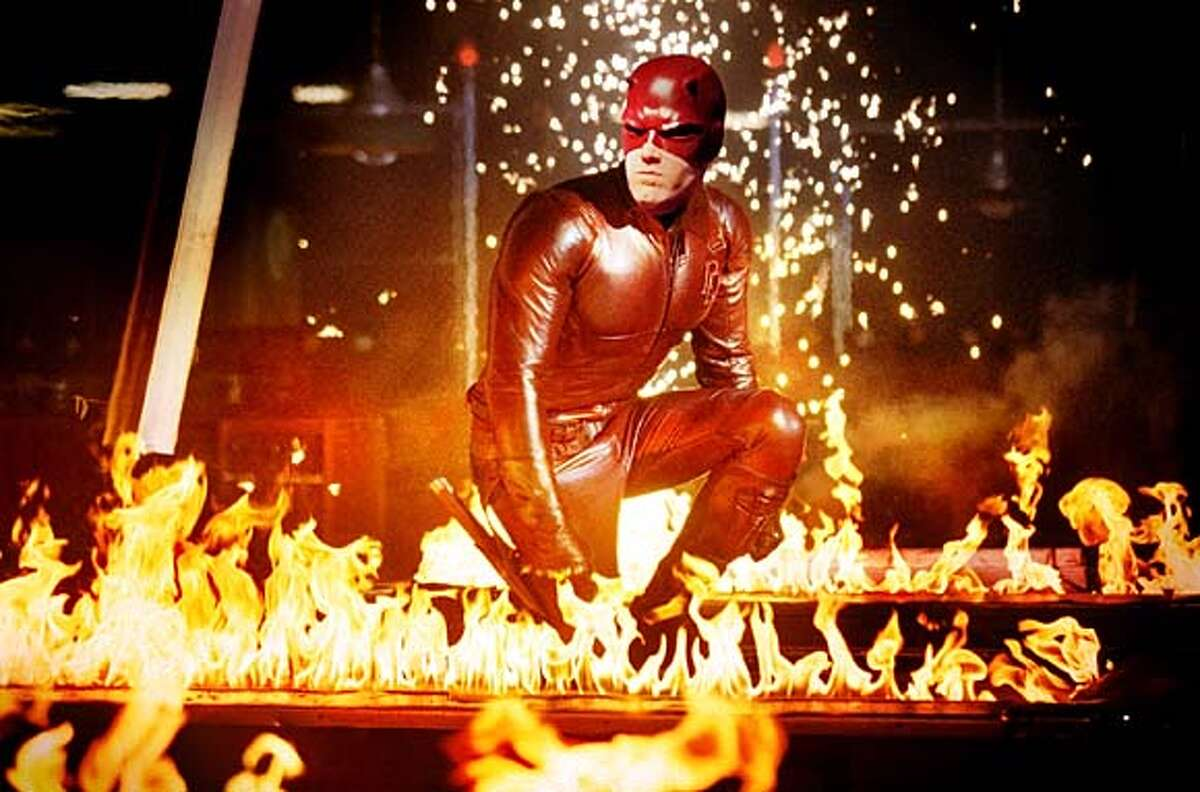 """THIS IS A HANDOUT IMAGE. PLEASE VERIFY RIGHTS. Daredevil (Ben Affleck) makes a fiery entrance in the film """"Daredevil."""""""