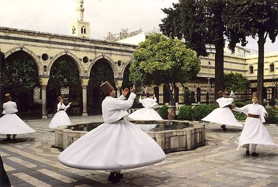 The Whirling Dervishes of Damascus (Syria) Touring Fall 2004 in U.S. with Ensemble Al-Kindi photo courtesy of Zamzama Mgmt  press info CindyByram@aol.com  212-545-7536 x 21 Photo: Zamzama Management