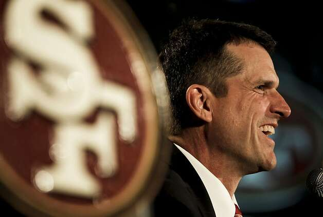 "Jim Harbaugh, left, doesn't want the family angle to take attention from the players. John says, as history, ""It's not exactly like Churchill and Roosevelt."" Photo: Michael Macor, The Chronicle"