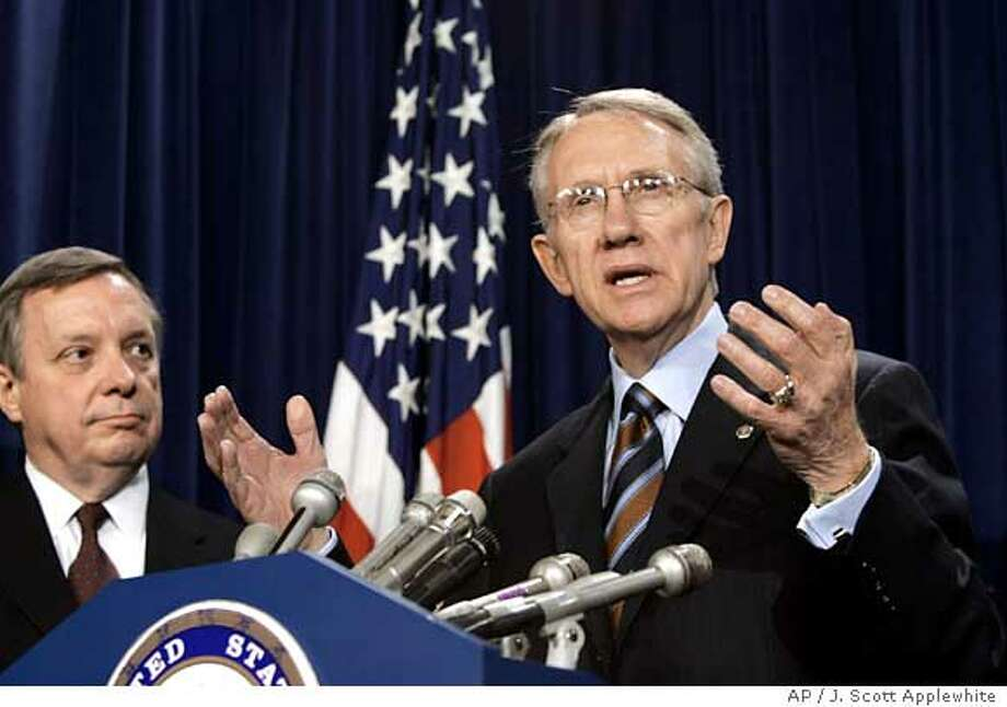 Sen. Harry Reid, D-Nev., speaks to reporters in the Capitol after winning election by his Democratic peers as the new Senate minority leader for the next session of Congress, in Washington, Tuesday, Nov. 16, 2004. Reid succeeds Sen. Tom Daschle, D-SD, who was defeated for re-election on Nov. 2 in South Dakota. Reid will be assisted by Sen. Dick Durbin, D-Ill., left, as the party's whip, the Democrat's second-ranking Senate leader. (AP Photo/J. Scott Applewhite) Ran on: 11-17-2004  Sen. Harry Reid and Sen. Dick Durbin (left), the Democrats' party whip, will command reduced ranks of only 44 senators. Photo: J. SCOTT APPLEWHITE