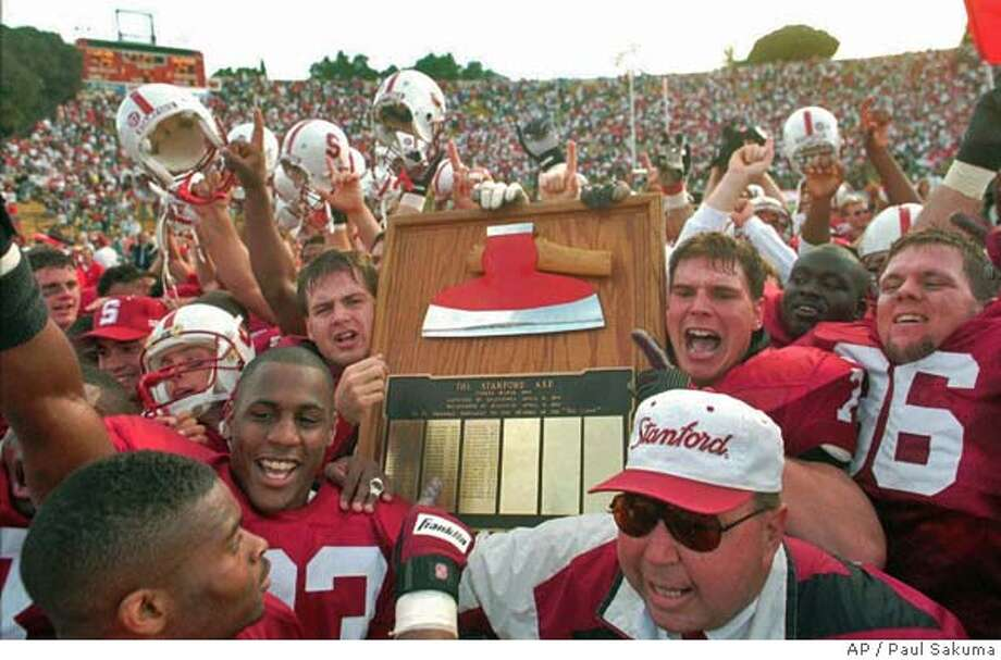 "FILE--Stanford University football players hold up the ceremonial axe trophy after they beat University of California-Berkeley 29-24 at Stanford, Calif., Stadium in the ""Big Game,"" in Saturday, Nov. 18, 1995. Stanford and Cal meet agains in the ""BIg Game: on Saturday, Nov. 22, 1997.(AP Photo/Paul Sakuma) rasn in SPECIAL SPORTS SECTION/ FOOTBALL '98 CAT Sports#Sports#Chronicle#11/20/2004#ALL#5star##421952588 Photo: PAUL SAKUMA"