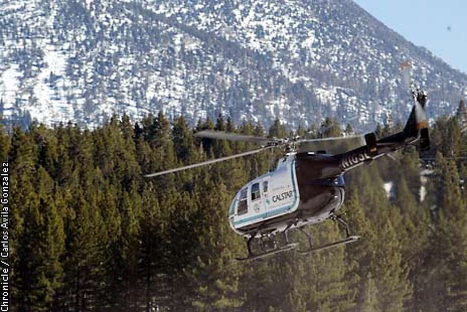 A CALSTAR chopper lifts off from the South Lake Tahoe airport en route to another rescue mission in het nearby mountains. Chronicle photo by Carlos Avila Gonzalez