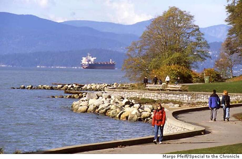 Folks walk along the seawall in Vancouver's Stanley Park. Photo by Margo Pfeiff/Special to the Chronicle