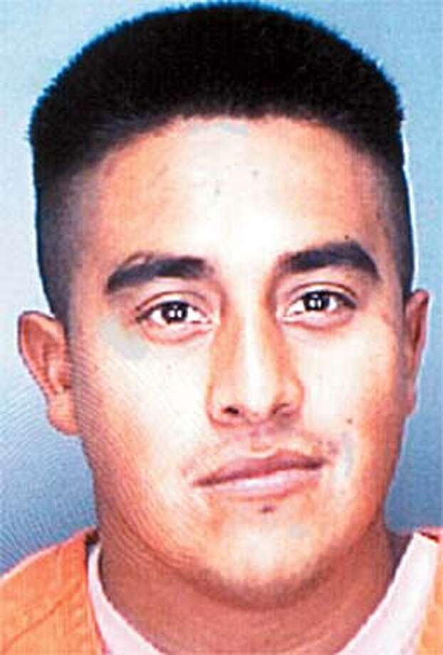 Booking mug of Miguel Loza, charged with slashing throat of one girl then rapeing another. HANDOUT. Photo: Handout