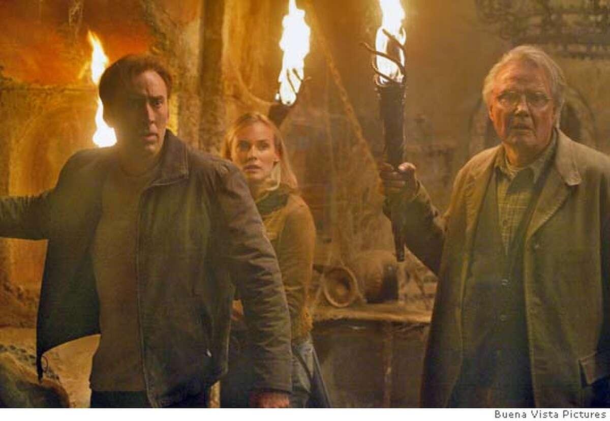 NATIONAL19 (L-R) Nicolas Cage, Diane Kruger, Jon Voight in National Treasure. Robert Zuckerman/Buena Vista Pictures Datebook#Datebook#Chronicle#11/19/2004##Advance##0422471797