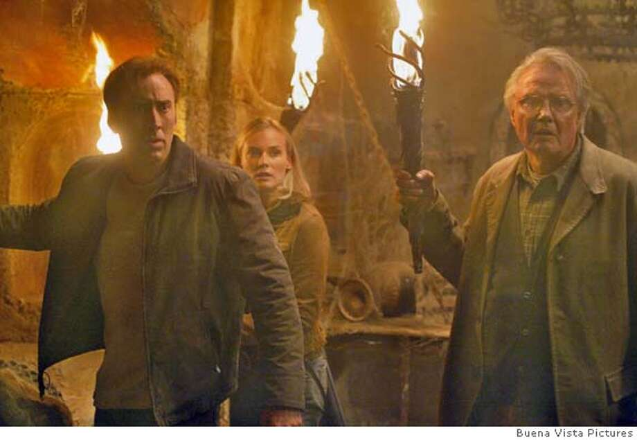 NATIONAL19 (L-R) Nicolas Cage, Diane Kruger, Jon Voight in National Treasure. Robert Zuckerman/Buena Vista Pictures Datebook#Datebook#Chronicle#11/19/2004##Advance##0422471797