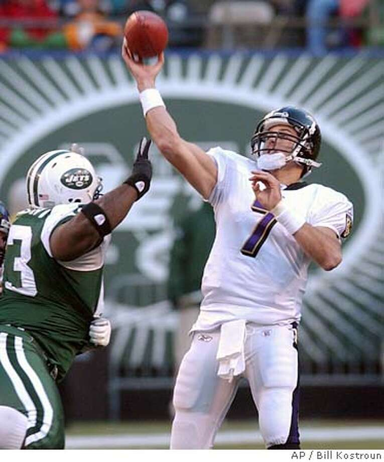 Baltimore Ravens quarterback Kyle Boller, right releases a pass as he is pressured by New York Jets defensive tackle Dewayne Robertson during the third quarter Sunday, Nov. 14, 2004 at Giants Stadium in East Rutherford, N.J. Boller completed 19 of 33 passes for 213 yards and two touchdowns as the Ravens beat the Jets in overtime, 20-17. (AP Photo/Bill Kostroun) Sports#Sports#Chronicle#11/19/2004#ALL#5star##0422467173 Photo: BILL KOSTROUN