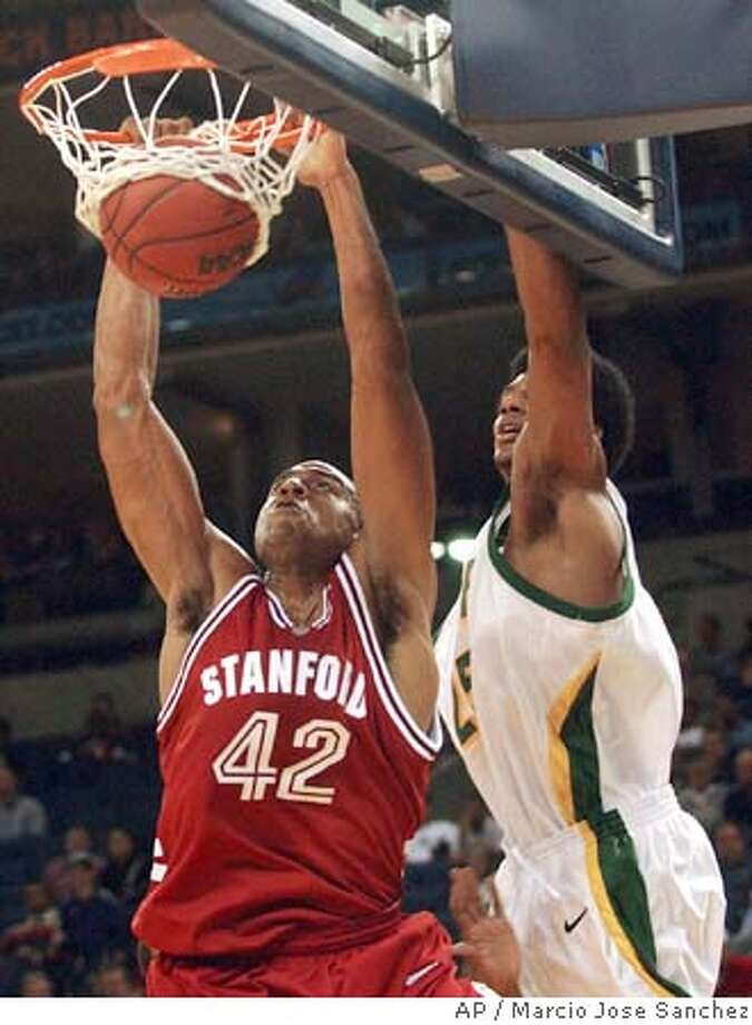 Stanford's Rob Little, left, dunks the ball in front of San Francisco's Alan Wiggins Jr. during the first half of the Pete Newell Challenge on Friday, Nov. 19, 2004, in Oakland, Calif. (AP Photo/Marcio Jose Sanchez) Photo: MARCIO JOSE SANCHEZ