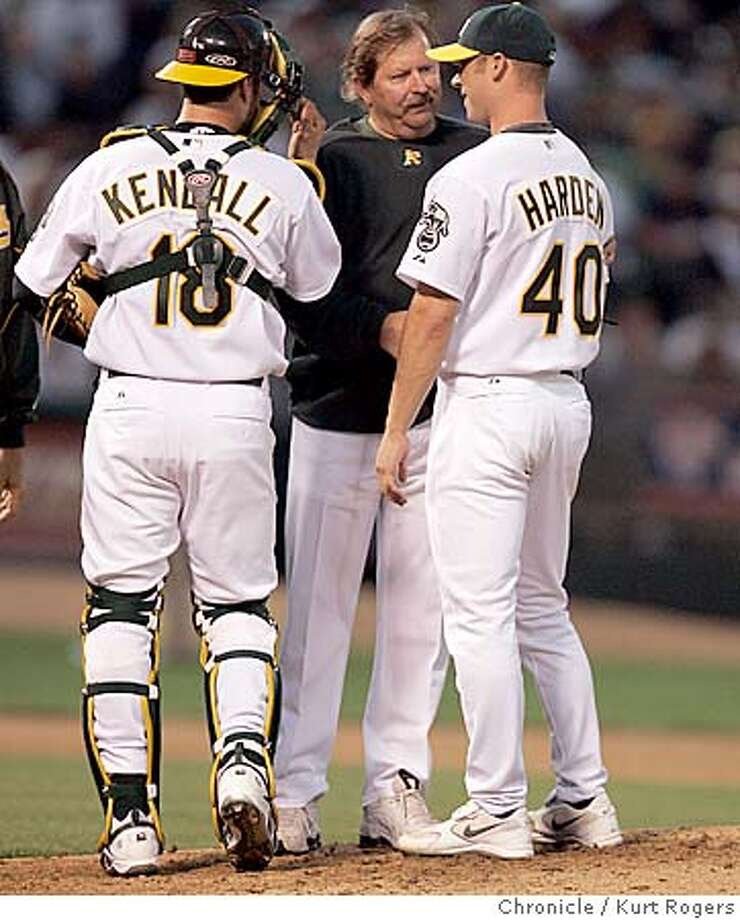 Rich Harden is checked by the A's trainer then taken out of the game .  New York Yankees vs. Oakland Athletics at the McAfee Coliseum . 5/13/05 in Oakland,CA.  KURT ROGERS/THE CHRONICLE Photo: KURT ROGERS