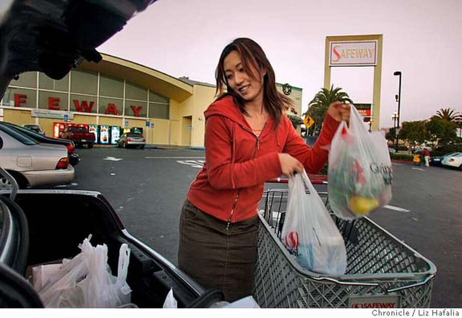 LATIN20_011_LH.JPG Brenda Miyafuji from San Francisco loading her groceries into her trunk at Safeway on Market at Dolores streets. Plastic bags used at grocery stores and shops, such as Safeway will be 17 cents a bag for providers. Shot on 11/19/04 in San Francisco. LIZ HAFALIA/The ChroniclePLASTIC_011_LH.JPG Plastic bags used at grocery stores and shops, such as Safeway may be taxed 17 cents a bag. Shot on 11/19/04 in San Francisco. LIZ HAFALIA/The Chronicle MANDATORY CREDIT FOR PHOTOG AND SF CHRONICLE/ -MAGS OUT Metro#MainNews#Chronicle#11/20/2004#ALL#5star##0422476023 Photo: Liz Hafalia
