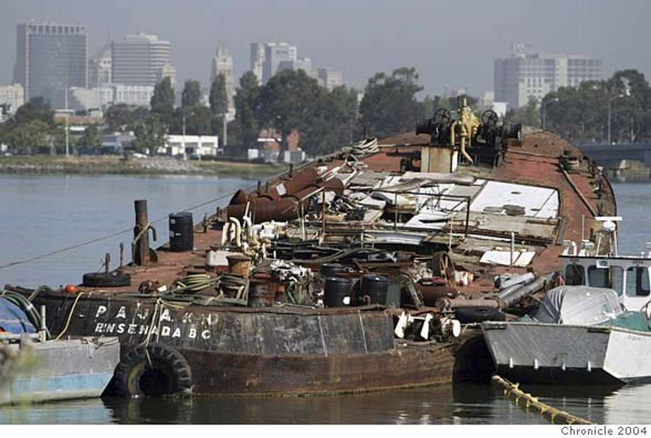"cwpajaro_003_pc.jpg FOR CHRONWATCH: Abandoned boats in Alameda :The ""Pajaro-Ensenada, BC"" partially sunken boat on the Alameda estuary shoreline has been an eyesore for over a year and one tipster wonders if it poses a potential hazard to the estuary. He's contacted several agencies and no one will take responsiblity for it. Alameda on 6/15/04. Also known as the Elizabeth A STAFF/The Chronicle Ran on: 08-18-2004 Ran on: 08-18-2004 Ran on: 11-08-2004 Ran on: 11-08-2004 Ran on: 02-20-2005 Ran on: 02-20-2005 Ran on: 02-20-2005 MANDATORY CREDIT FOR PHOTOG AND S.F. CHRONICLE/ - MAGS OUT Photo: STAFF"