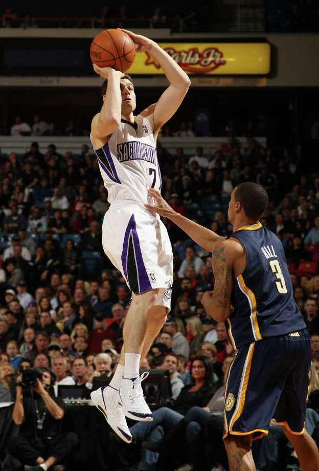SACRAMENTO, CA - JANUARY 18:  Jimmer Fredette #7 of the Sacramento Kings shoots over George Hill #3 of the Indiana Pacers at Power Balance Pavilion on January 18, 2012 in Sacramento, California. NOTE TO USER: User expressly acknowledges and agrees that, by downloading and or using this photograph, User is consenting to the terms and conditions of the Getty Images License Agreement. Photo: Ezra Shaw, Getty Images / 2012 Getty Images
