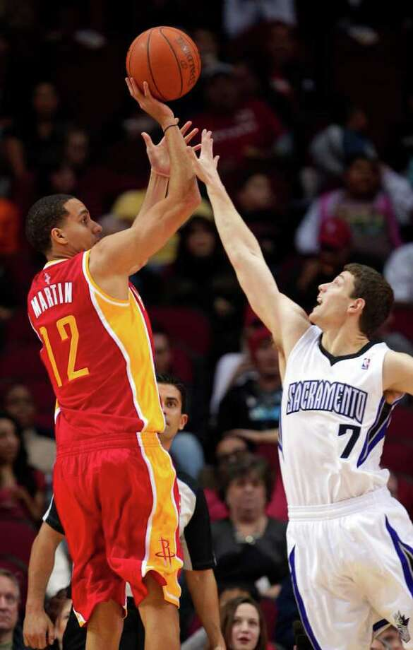 Houston Rockets' Kevin Martin (12) shoots over Sacramento Kings' Jimmer Fredette (7) during the first quarter of an NBA basketball game Friday, Jan. 13, 2012, in Houston. Photo: David J. Phillip, AP / AP