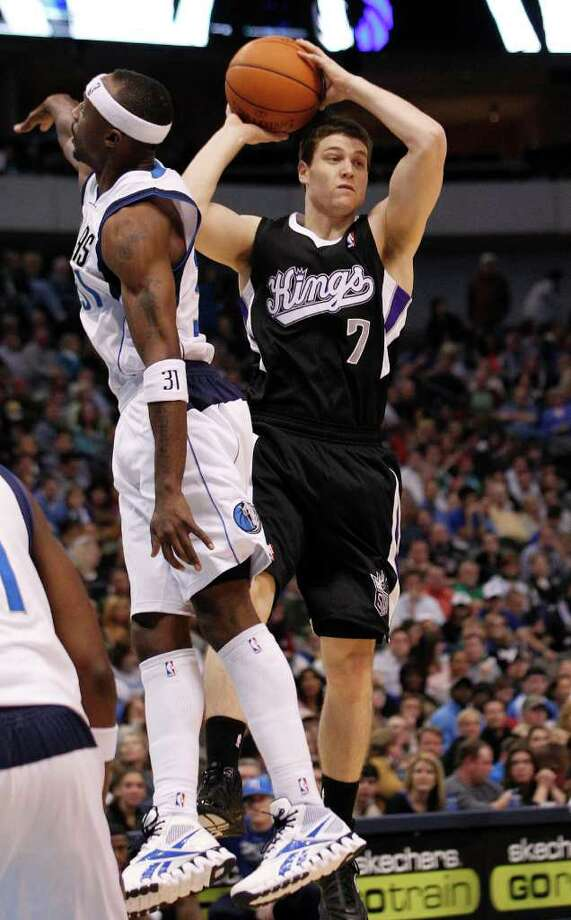Sacramento Kings point guard Jimmer Fredette (7) jumps and looks to pass against Dallas Mavericks shooting guard Jason Terry (31) during the second half of an NBA basketball game in Dallas,  Saturday, Jan. 14, 2012.  The Mavericks won 99-60. Photo: LM Otero, AP / AP