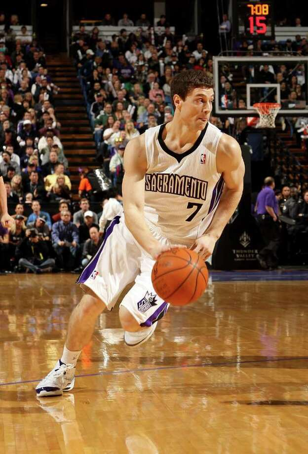 SACRAMENTO, CA - JANUARY 18:  Jimmer Fredette #7 of the Sacramento Kings dribbles to the basket during their game against the Indiana Pacers at Power Balance Pavilion on January 18, 2012 in Sacramento, California. NOTE TO USER: User expressly acknowledges and agrees that, by downloading and or using this photograph, User is consenting to the terms and conditions of the Getty Images License Agreement. Photo: Ezra Shaw, Getty Images / 2012 Getty Images