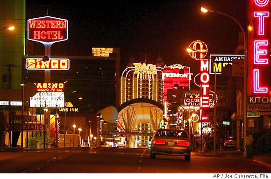 "** ADVANCE FOR THE WEEKEND JUNE 26 - 27 ** The Western Hotel and Casino, left, is seen on Fremont Street in Las Vegas, Wednesday, June 23, 2004. The casino is down the street from downtown, which is in turn down the street from the Las Vegas Blvd. ""strip."" The Western is a poor man's dream, a place where sad Las Vegas cliches collide. (AP Photo/Joe Cavaretta) ADVANCE FOR JUNE 26 - 27 Metro#Metro#Chronicle#6/27/2004#ALL#2star##0422162655 Ran on: 06-27-2004  The Western Hotel-Casino on Fremont Street in Las Vegas is a far cry from the glitter of such places as Bally's and Mandalay Bay. Photo: JOE CAVARETTA"
