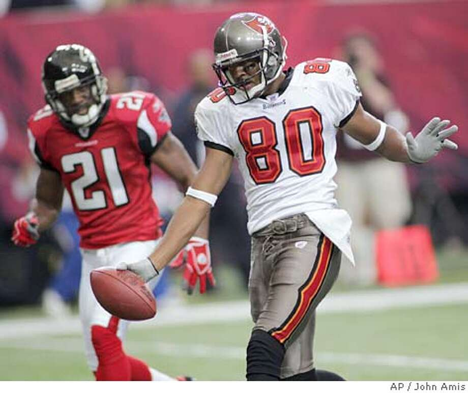 Tampa Bay Buccaneers wide receiver Michael Clayton (80) celebrates his first- half touchdown in front of Atlanta Falcons cornerback DeAngelo Hall (21) at the Georgia Dome in Atlanta, Sunday, Nov. 14, 2004. (AP Photo/John Amis) Sports#Sports#Chronicle#11/19/2004#ALL#5star##0422466858 Photo: JOHN AMIS