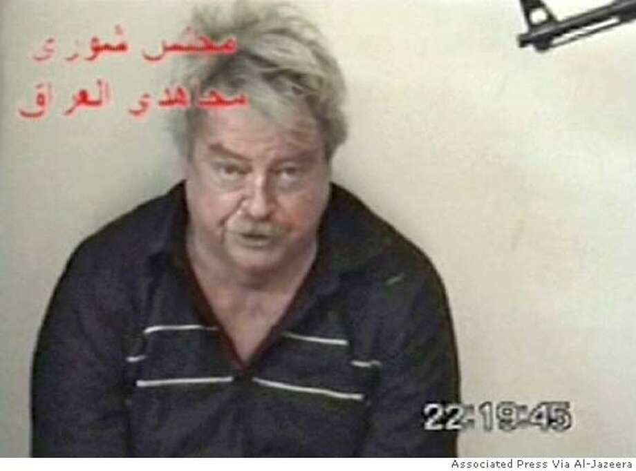 A grab frame of kidnapped 63-year-old Australian engineer Douglas Wood pleading for his life at an unknown location in Iraq. The video was delivered to western news agencies in Baghdad, 01 May 2005. The videotape bears the words Shura Council of the Mujahedeen of Iraq. The group has previously claimed responsibility for attacks on US soldiers and Iraqi forces, as well as the kidnapping of a Turk who was freed in September. Australian Prime Minister John Howard vowed 02 May 2005 to stand firm in the face of insurgent demands to withdraw his forces from Iraq following Wood's adbduction. AFP PHOTO/HO (Photo credit should read /AFP/Getty Images) DV Ran on: 05-09-2005  Douglas Wood was held at gunpoint in this photo from the first video given to Al-Jazeera. Ran on: 05-09-2005