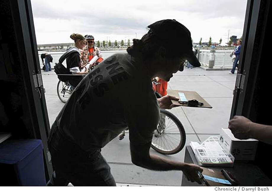 """Kash,"" (as he calls himself-goes by one name), takes in bikes at the Bike Parking Facility at SBC Park where he runs a ""bike valet,"" South of the stadium on the Portwalk above McCovey Cove. Kash runs the service for the San Francisco Bicycle Coalition. Event on 4/23/05 in San Francisco.  Darryl Bush / The Chronicle Photo: Darryl Bush"