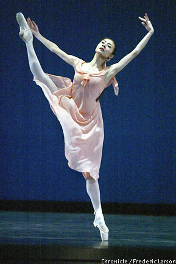 "Yuan Yuan Tan in the San Francisco Ballet's production of Jerome Robbins' ""Dances at a Gathering."" Chronicle photo by Frederic Larson"