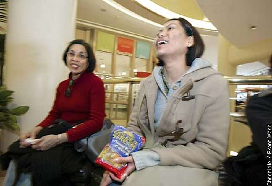 22 year old Celisse DeOcera, right, and her mom Linda love shopping at the San Francisco Centre...they are anxious for a bigger and better shopping complex as proposed...they make their home in Hayward...they BART to SF. By Brant Ward/Chronicle Photo: BRANT WARD