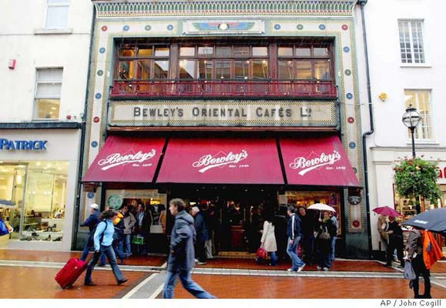 TRAVEL DUBLIN, Ireland -- Bewley's Cafe in Grafton Street Dublin, Ireland Friday Oct. 29, 2004. The owners of Bewley's Oriental Cafes, Ireland's famous tea and coffee shops, announced Friday that their two flagship cafes in central Dublin _ among the capital's most revered cultural landmarks for decades _ will shut next month because they can no longer run profitably. (AP photo/ John Cogill) Travel#Travel#Chronicle#11/14/2004#ALL#Advance##0422458709 Photo: JOHN COGILL