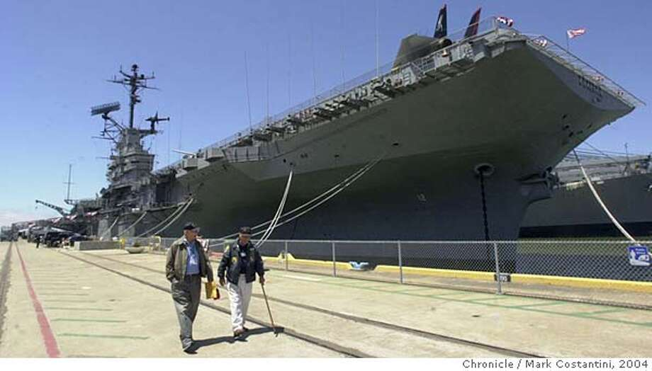 (FROM LEFT) JOE FOLTZ AND BUZZ JONES, DOCENTS ON THE SHIP WALK NEAR IT.  AT THE USS HORNET MUSEUM ON THE 35TH ANNIVERSARY OF THE APOLLO LANDING ON THE MOON. PHOTO TAKEN ON 7/20/04 IN ALAMEDA. Chronicle Photo by Mark Costantini Photo: MARK COSTANTNI