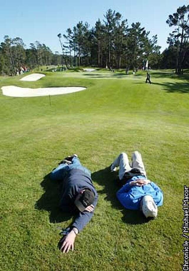 Dan Bullock, left and Mick Mullen both from Alameda soak up a little sun along the edge of the 7th hole at Poppy Hills. First round of the Pebble Beach Pro-Am by Michael Macor/The Chronicle Photo: MICHAEL MACOR