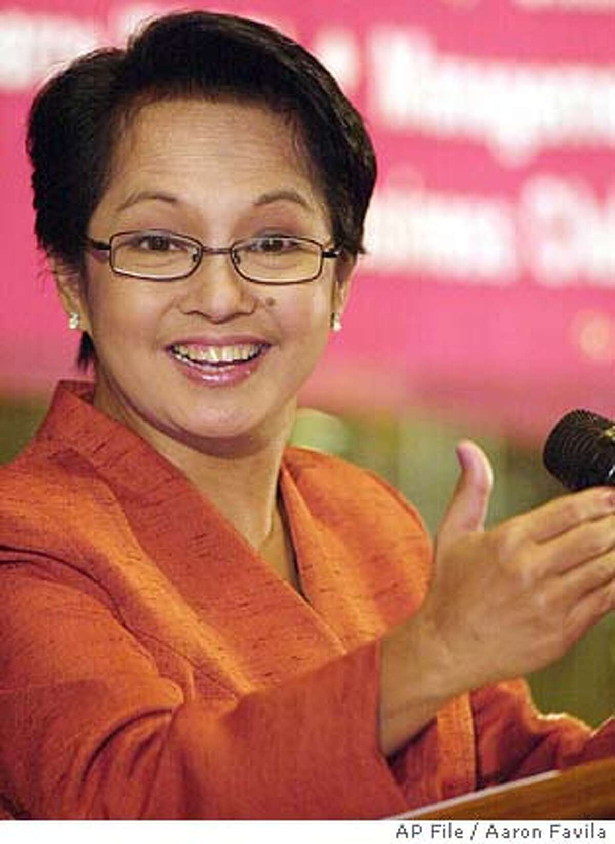** FILE ** Philippine President Gloria Macapagal Arroyo gestures as she meets businessmen at the financial district of Makati, south of Manila in this April 14, 2004 file photo. President Gloria Macapagal Arroyo has won another term in office, according to final results Sunday, June 20, 2004, from the May 10 election. (AP Photo/Aaron Favila) Ran on: 06-21-2004 Gloria Macapagal Arroyo won the Philippine presidential election by 1,123,576 votes.