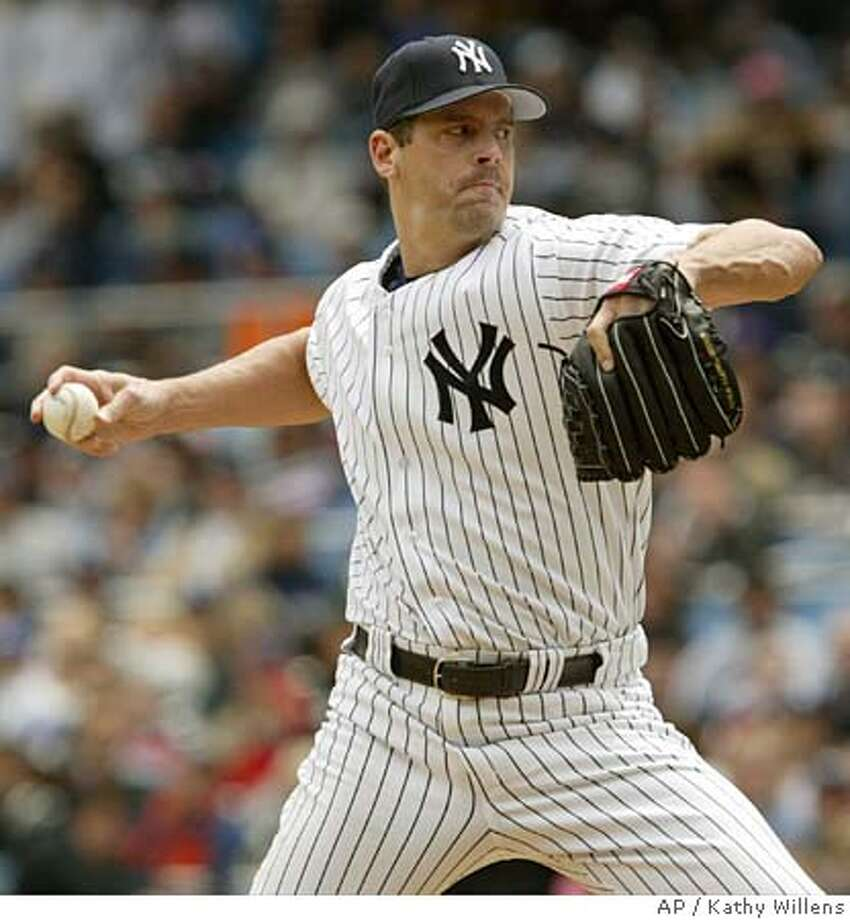 New York Yankees pitcher Kevin Brown delivers a pitch in the first inning of the Yankees 6-0 shutout of the Oakland Athletics, Sunday, May 8, 2005, at Yankee Stadium in New York. (AP Photo/Kathy Willens) Photo: KATHY WILLENS