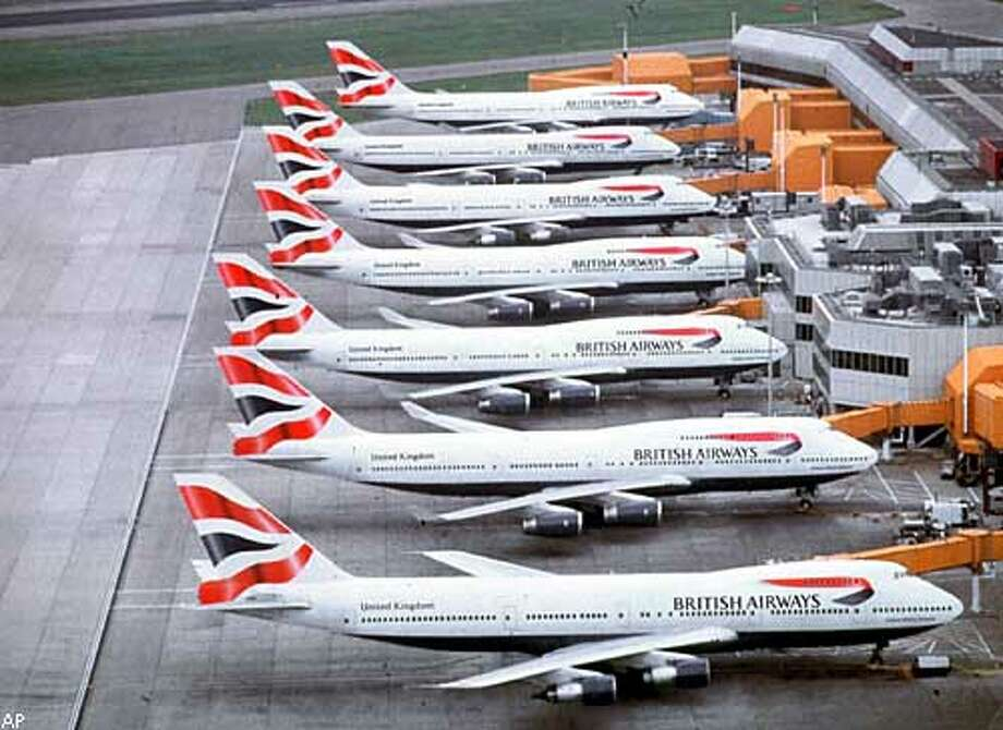 FILE - Undated recent picture shows a lineup of British Airways 747's on a London airport tarmac. British Airways is to begin talks with Dutch airline KLM over a possible merger of the two companies, it announced Wednesday June 7 2000. A deal between the rivals would create Europe's biggest airline and the third largest in the world. (AP PHOTO/PA) UNITED KINGDOM OUT. MAGAZINES OUT.