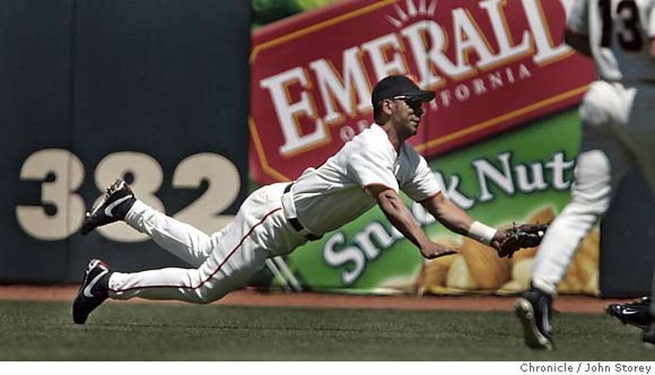 Giant's left fielder Moises Alou makes a diving catch of Daryle Ward's hit to left field in the 7th inning. The Giants lose to the Pirates at SBC Park. John Storey San Francisco Event on 5/11/05 Photo: John Storey