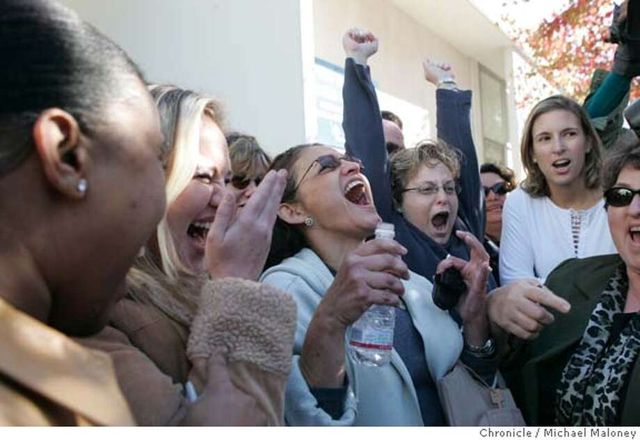 Reaction outside the San Mateo County Courthouse as the verdict was announced. (They were listening to a radio) Neve Fellowes is 2nd from left and next to her holding water bottle is Carmen Ruiz, both of San Mateo.  A verdict was reached in the Scott Peterson murder trial at the San Mateo County (CA) Courthouse this afternoon. He was found guilty of 1st and 2nd degree murder. Peterson was found guilty of murdering his pregnant wife and his unborn son and dumping her body in the San Francisco Bay Christmas Eve, 2002. Photo by Michael Maloney / San Francisco Chronicle Photo: Michael Maloney